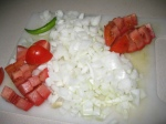 cut the onions, tomato and green chilly
